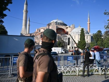Turkish special force police officers patrol in front of Hagia Sophia during the preparations for the Friday prayer in Istanbul, on July 23, 2020. - The first prayers at Hagia Sophia since the Istanbul landmark was reconverted to a mosque will take place on July 23, 2020. Turkey's top court …