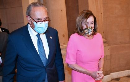House Speaker Nancy Pelosi, D-CA, (R) and US Senate Minority Leader Chuck Schumer, D-NY, make their way to speak to the media, after meeting with the White House Chief of Staff and the US Treasury Secretary on coronavirus relief at the US Capitol in Washington, DC on August 7, 2020. …