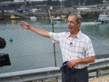 DOVER, ENGLAND - AUGUST 12: Brexit Party leader Nigel Farage speaks to supporters and media on August 12 2020 in Dover, England. Favourable weather conditions in recent weeks have led to a rise in people attempting to cross the channel, with more than 200 people arriving on the Kent coast …