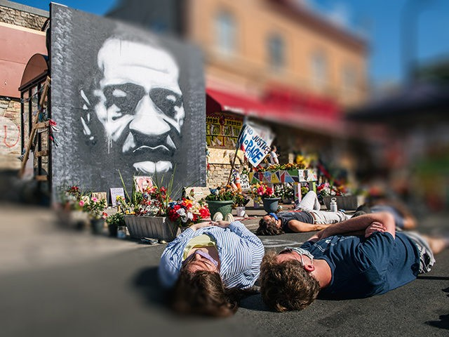 MINNEAPOLIS, MN - AUGUST 17: People participate in a die-in during a demonstration on August 17, 2020 in Minneapolis, Minnesota. Community members came together for a rally to protest the city's potential forceful reopening 38th Street and Chicago Ave, an unofficial autonomous zone known as George Floyd Square. Community activists …