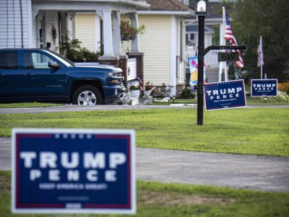 """Trump-Pence"" signs and banners are seen on a street in Olyphant, just outside Scranton, Pennsylvania, on August 11, 2020. - It is not hard to miss the border between the industrial, mostly Democratic city of Scranton, Pennsylvania -- Joe Biden's hometown -- and its decidedly more right-leaning outskirts: amid all …"