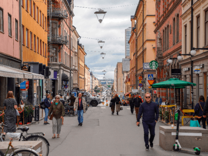 This picture taken in Stockholm, Sweden, on August 31, 2020, shows people walking in a street in Stockholm, amid the novel coronavirus pandemic. - While most of the world has come to terms with covering their noses and mouths in crowded places as a measure to prevent the spread of …
