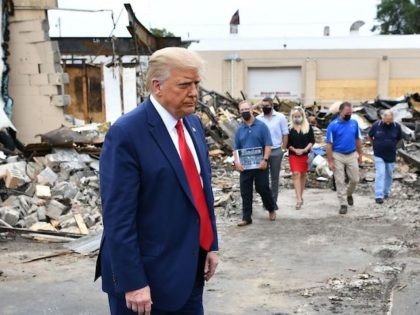 US President Donald Trump tours an area affected by riots in Kenosha, Wisconsin on September 1, 2020.