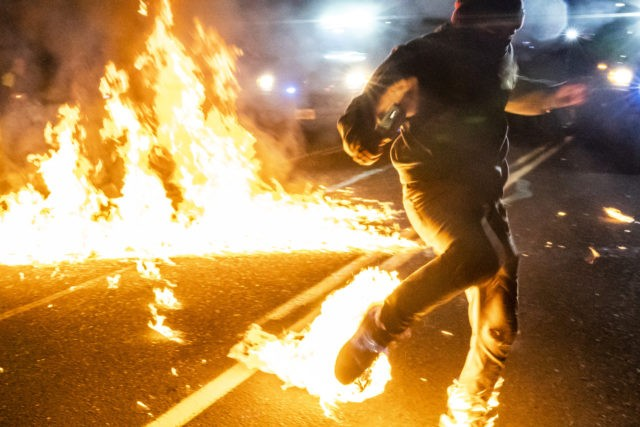 VANCOUVER WASH - SEPTEMBER 5: A protester, whos feet caught fire after a molotov cocktail exploded on him, runs toward a medic during a protest against police brutality and racial injustice on September 5, 2020 in Portland, Oregon. Portland has seen nightly protests for the past 100 days following the …