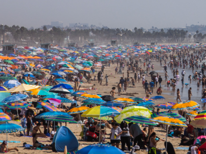 People gather on the beach on the second day of the Labor Day weekend amid a heatwave in Santa Monica, Caifornia on September 6, 2020. (Photo by Apu GOMES / AFP) (Photo by APU GOMES/AFP via Getty Images)