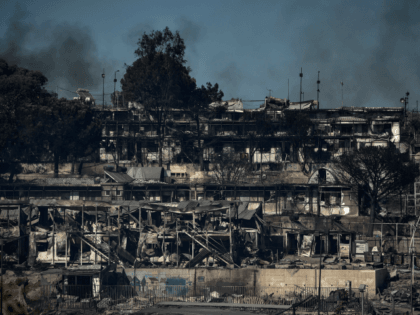 TOPSHOT - A picture taken on September 10, 2020 in Moria shows the Moria refugee camp, two days after Greece's biggest and most notorious migrant camp, was destroyed by fire. - Thousands of asylum seekers on the Greek island of Lesbos languished on roadsides on Thursday, homeless and hungry after …