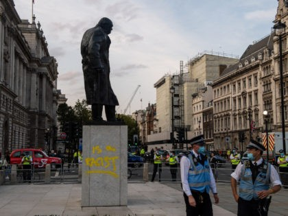 LONDON, ENGLAND - SEPTEMBER 10: The statue of Sir Winston Churchill is seen vandalised with spray paint as an Extinction Rebellion protest takes place in Parliament Square on September 10, 2020 in London, England. The Sir Winston Churchill statue was vandalised with the same message earlier in the year during …