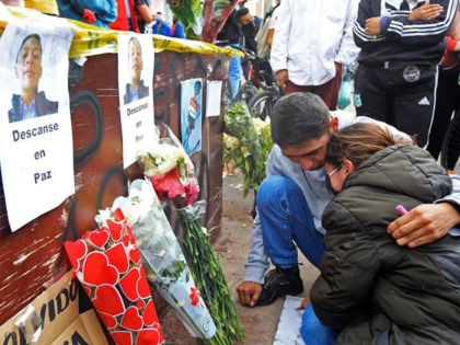 David and Lina Hernandez mourn during a tribute to their brother Cristian Hernandez in Bogota, on September 10, 2020, who was killed during a protest against police brutality. - At least 10 people were killed and hundreds wounded after rioting broke out in the Colombian capital Bogota during protests over …