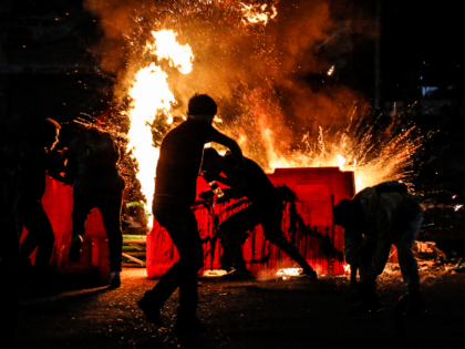 Demonstrators set a barricade on fire during a protest against police brutality in Cucuta, on the Colombian border with Venezuela, on September 10, 2020. - At least 10 people were killed and hundreds wounded after rioting broke out in the Colombian capital Bogota during protests over the death of a …