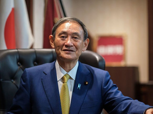 Newly elected leader of Japan's Liberal Democratic Party (LDP) Yoshihide Suga poses for a portrait at his office following his press conference at the party's headquarters in Tokyo on September 14, 2020. - Japan's ruling party on September 14 elected chief cabinet secretary Yoshihide Suga its new leader, making him …