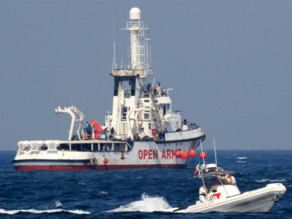 A patrol boat of the Italian Coast Guards (Guardia Costiera) sails past the rescue vessel of Spanish NGO Open Arms on September 17, 2020 off the port of Palermo, Sicily, after another patrol boat of the Guardia Costiera rescued a group of 76 migrants who threw themselves into the sea …