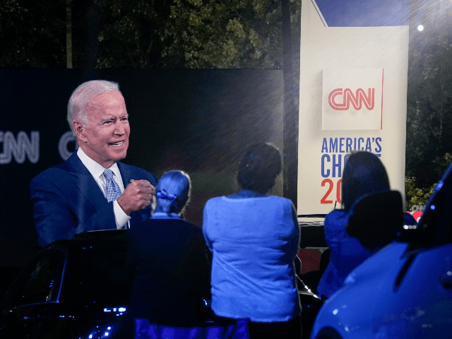 Audience members listen as Democratic presidential nominee and former Vice President Joe Biden participates in a CNN town hall event on September 17, 2020 in Moosic, Pennsylvania. Due to the coronavirus, the event is being held outside with audience members in their cars. Biden grew up nearby in Scranton, Pennsylvania. …