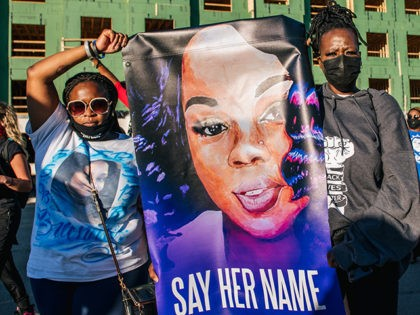 LOUISA, KY - SEPTEMBER 18: Two women hold a sign of Breonna Taylor during a rally on September 18, 2020 in Louisville, Kentucky. Protestors rallied in front of the Office Of The Attorney General headquarters to speak in preparation for a decision to be made regarding the officers involved in …