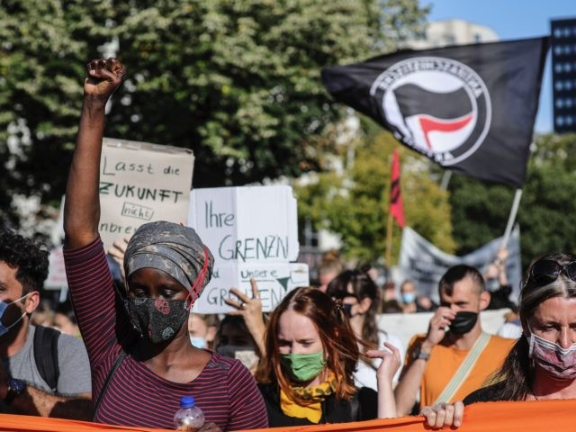 BERLIN, GERMANY - SEPTEMBER 20: Protesters gather to demand the immediate evacuation of Greek island refugee camps on September 20, 2020 in Berlin, Germany. The protest follows the recent fire at the Moria camp on Lesbos that left approximately 13,000 refugees homeless. The German government has announced it will take …