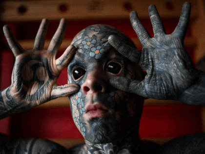 French primary school teacher and tattoo enthusiast Sylvain Helaine, known as Freaky Hoody, poses during a photo session in Palaiseau, a south of Paris suburb, on September 22, 2020. (Photo by Christophe ARCHAMBAULT / AFP) (Photo by CHRISTOPHE ARCHAMBAULT/AFP via Getty Images)