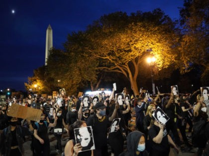 WASHINGTON, DC - SEPTEMBER 23: Demonstrators march near the White House in protest following a Kentucky grand jury decision in the Breonna Taylor case on September 23, 2020 in Washington, DC. A Kentucky grand jury indicted one police officer involved in the shooting of Breonna Taylor with 3 counts of …