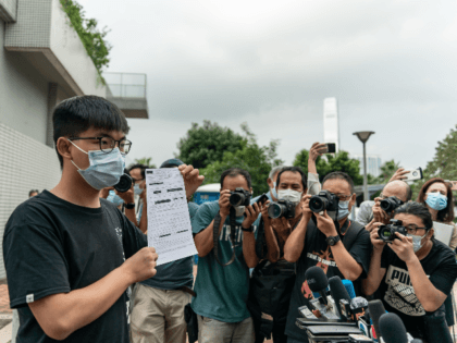 Pro-democracy activist Joshua Wong speaks to members of media as he holds a bail document after leaving Central police station on September 24, 2020 in Hong Kong, China. Wong was arrested for allegedly participating in an unauthorized assembly on Oct. 5, 2019 and violating an anti-mask law that was introduced last …