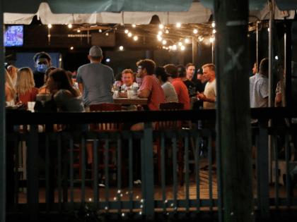 Patrons pack a bar to have drinks on the first day of full capacity seating is allowed on September 25, 2020 in Tampa, Florida. Florida Governor Ron DeSantis allows bars and restaurants to enter Phase 3 amid the coronavirus pandemic. (Photo by Octavio Jones/Getty Images)