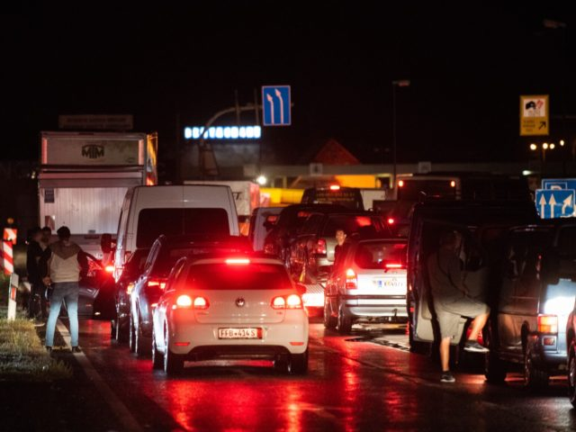 NICKELSDORF, AUSTRIA - SEPTEMBER 01: Cars queue up on the Austrian-Hungarian boarder coming from Austria shortly after Hungary imposed a ban on the arrival of non-resident foreigners on September 01, 2020 at Nickelsdorf, Austria. The Hungarian government announced the measure in roder to bring the Covid-19 infection rate in the …