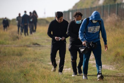 DEAL, ENGLAND - SEPTEMBER 15: Recently landed migrants walk along the coast on September 15, 2020 at Kingsdown Beach in Deal, England. More than 6,100 migrants have made the crossing by boat this year according to an analysis by the Press Association. (Photo by Luke Dray/Getty Images)