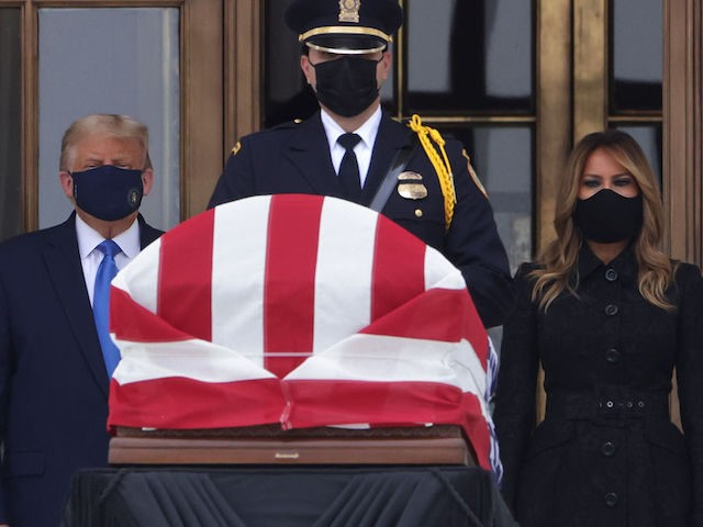 WASHINGTON, DC - SEPTEMBER 24: U.S. President Donald Trump and first lady Melania Trump pay their respects to Associate Justice Ruth Bader Ginsburg's flag-draped casket on the Lincoln catafalque on the west front of the U.S. Supreme Court September 24, 2020 in Washington, DC. A pioneering lawyer and according the …