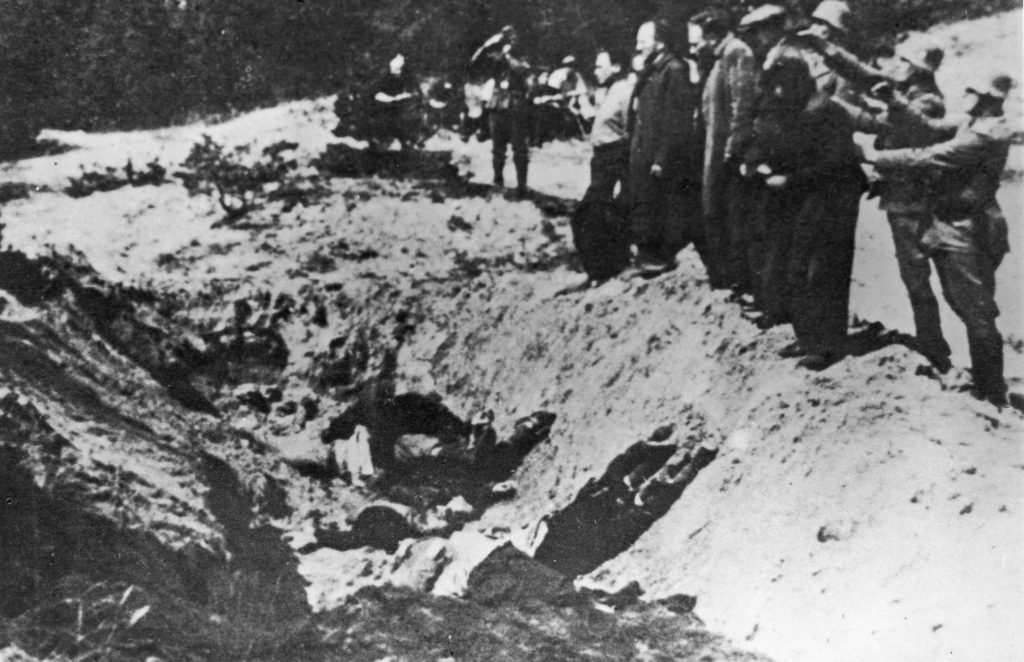 Nazi SS Special Commanders line up Kiev Jews to execute them with guns and push them in to a ditch, already containing bodies of victims, The Babi Yar Massacre, World War II, Poland, 1941 (Photo by Hulton Archive/Getty Images).