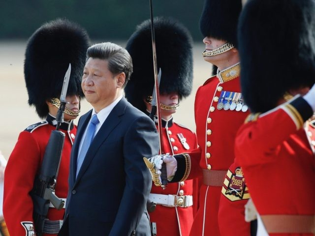 Chinese President Xi Jinping is escorted as he inspects a guard of honour during the official welcome ceremony at Horse Guards Parade in London, Tuesday, Oct. 20, 2015. Chinese President Xi Jinping arrived in Britain Monday for a four-day state visit as part of a push to increase trade ties …