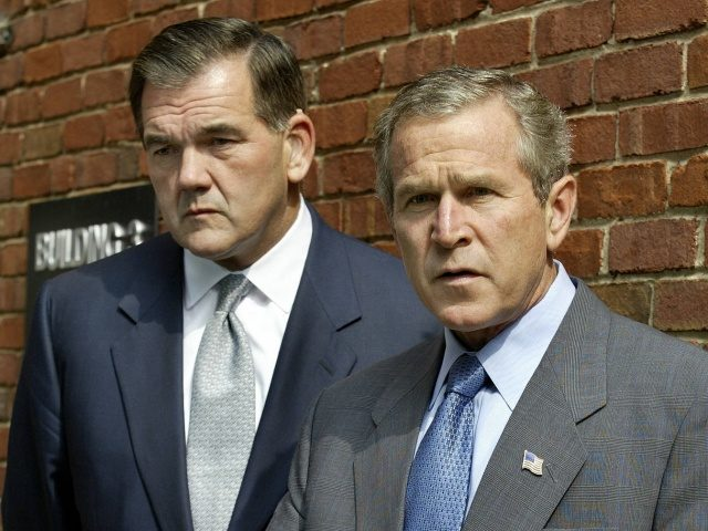 WASHINGTON, : US President George W. Bush(R) answers a reporter's question at the Nebraska Avenue Homeland Security Complex in Washington, D.C. 19 September 2002 as US Director of Homeland Security Tom Ridge(L) stands by. Bush is asking the U.S. Congress to support the possible use of military force against Iraq. …