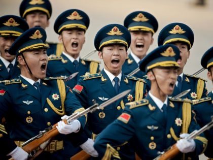 Paramilitary guards shout during a welcoming ceremony for Argentine President Mauricio Macri outside the Great Hall of the People in Beijing on May 17, 2017. Macri is on a state visit to China after attending the Belt and Road Forum on May 14-15. / AFP PHOTO / POOL / Nicolas …