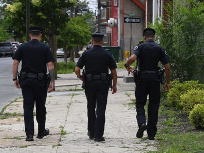 Camden County Police Department officer Jose Delvalle, Louis Sanchez and Vidal Riverago out on patrol in Camden, New Jersey, on May 24, 2017.