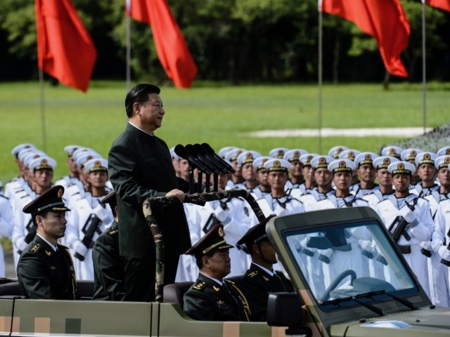 Tanks, missile launchers and chanting troops greeted President Xi Jinping in a potent display of Chinese military might on June 30 as part of his landmark visit to politically divided Hong Kong. / AFP PHOTO / Anthony WALLACE (Photo credit should read ANTHONY WALLACE/AFP via Getty Images)