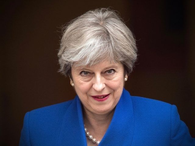 LONDON, ENGLAND - JULY 19: Britain's Prime Minister, Theresa May, leaves for the weekly Prime Minister's Questions at the House of Commons on July 19, 2017 in London, England. This is the last Prime Minister's Questions before the summer recess. (Photo by Carl Court/Getty Images)