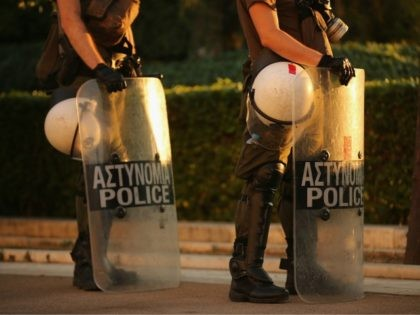 ATHENS, GREECE - JULY 13: Riot police stand by as protesters gather outside the Greek parliament to demonstrate against austerity after an agreement for a third bailout with eurozone leaders on July 13, 2015 in Athens, Greece. The bailout is conditional on Greece passing agreed reforms in parliament by Wednesday …