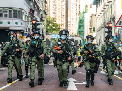 HONG KONG, CHINA - SEPTEMBER 06: Riot police charge on a street during an anti-government protest on September 6, 2020 in Hong Kong, China. Nearly 300 people were arrested during the protest against the government's decision to postpone the legislative council election due to the Covid-19 and the newly imposed …