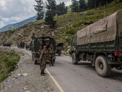 GAGANGIR, KASHMIR, INDIA - SEPTEMBER 2: Indian army convoy carrying reinforcements and supplies, drive towards Leh, on a highway bordering China, on September 2, 2020 in Gagangir, India. India and China, have stumbled once again into a bloody clash over their shared border. India rushed additional troops to Ladakh after …