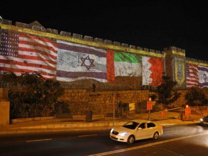 Jerusalem flags on walls (Menahem / AFP / Getty)