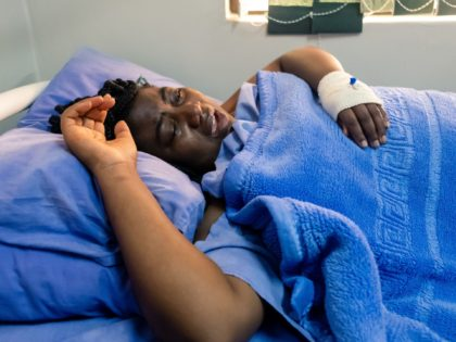 Joana Mamombe a Movement for Democratic Change (MDC) Alliance member of Parliament lying on a hospital bed at a private hospital in Harare on May 15, 2020, where she is one of the three youth leaders from the MDC Alliance who were admitted after allegedly being abducted and beaten up …