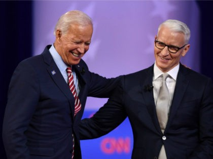 Democratic presidential hopeful former US Vice President Joe Biden (L) laughs with moderator CNN's Anderson Cooper during a town hall devoted to LGBTQ issues hosted by CNN and the Human rights Campaign Foundation at The Novo in Los Angeles on October 10, 2019. (Photo by Robyn Beck / AFP) (Photo …
