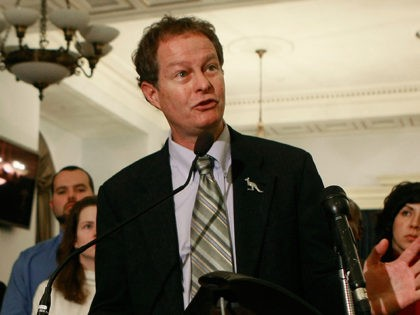 WASHINGTON - DECEMBER 09: John Mackey, CEO of Whole Foods, speaks while surrounded by Whole Foods employees during a news conference on Capitol Hill, December 9, 2008 in Washington, DC. Mackey announced a new legal challenge to the Federal Trade Commission's antitrust review of the proposed merger of Whole Foods …