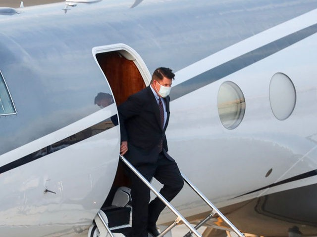 Keith Krach, US Undersecretary of State for Economic Growth, Energy and the Environment, alights from an aircraft after landing at the Sungshan airport in Taipei on September 17, 2020. - A top US diplomat landed in Taiwan on September 17, the highest-ranking State Department official to visit in 40 years, …