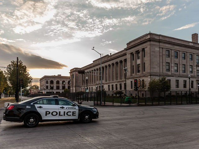 TOPSHOT - A Kenosha Police car drives past the Kenosha Courthouse surrounded by surrounded by temporary security gates during curfew in Kenosha, Wisconsin on August 31, 2020, following the shooting of Jacob Blake by police. - Donald Trump has no plans to meet with relatives of Jacob Blake, a black …