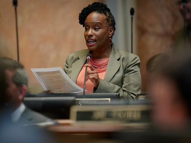 Kentucky Democratic State Representative Attica Scott speaks on the floor of the House of Representatives at the Capitol in Frankfort, Ky., Wednesday, March 2, 2020. (AP Photo/Bryan Woolston)