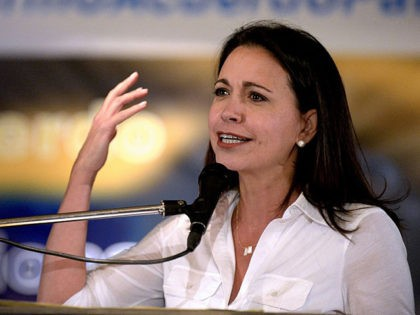 Venezuelan opposition leader Maria Corina Machado speaks during a rally in Caracas on February 24, 2015. Venezuelan pro-government deputies seeking the withdrawal of the parliamentary privileges of opposition deputy Julio Borges asked the General Prosecutor's office to investigate his alleged participation in a plot to oust President Nicolas Maduro, the …