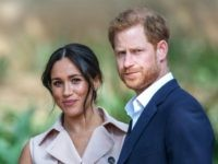 TOPSHOT - Britain's Prince Harry, Duke of Sussex(R) and Meghan, the Duchess of Sussex(L) arrive at the British High Commissioner residency in Johannesburg where they will meet with Graca Machel, widow of former South African president Nelson Mandela, in Johannesburg, on October 2, 2019. - Prince Harry recalled the hounding …