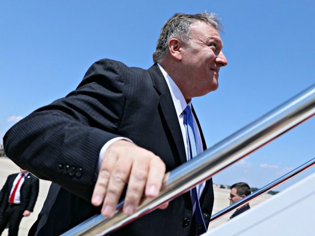 US Secretary of State Mike Pompeo boards his plane for travel to Thailand, and then on to Australia and the Federated States of Micronesia, from Joint Base Andrews, Maryland, on July 30, 2019. (Photo by JONATHAN ERNST / POOL / AFP) (Photo credit should read JONATHAN ERNST/AFP via Getty Images)