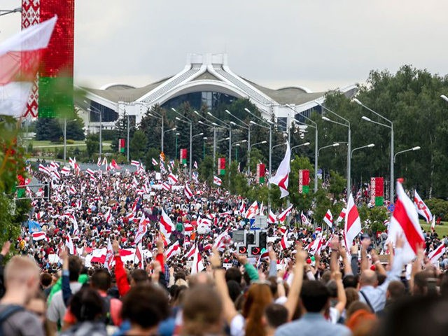 Belarus opposition supporters attend a rally to protest against the disputed August 9 presidential elections results in Minsk on September 6, 2020. - Tens of thousands of Belarusians staged a peaceful new march on September 6, keeping the pressure on strongman Alexander Lukashenko who has refused to quit after his …