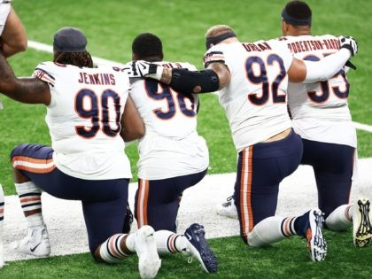 DETROIT, MI - SEPTEMBER 13: Members of the Chicago Bears football team take a knee during the playing of the national anthem prior to the start of the game against the Detroit Lions at Ford Field on September 13, 2020 in Detroit, Michigan. (Photo by Rey Del Rio/Getty Images)