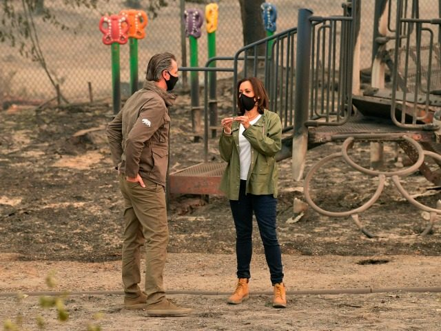 US Democratic vice presidential nominee and Senator from California, Kamala Harris chats with California Governor Gavin Newsom as they visit Pine Ridge Elementary School where they met with firefighters and toured fire-ravaged properties damaged from the Creek Fire nearby in an unincorporated area of Fresno, California on September 15, 2020. …