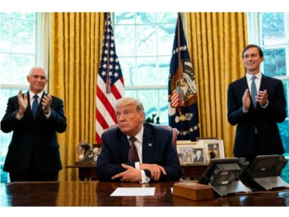 WASHINGTON, DC - SEPTEMBER 11: U.S. President Donald Trump, flanked by U.S. Vice President Mike Pence (L) and Advisor Jared Kushner, speaks in the Oval Office to announce that Bahrain will establish diplomatic relations with Israel, at the White House in Washington, DC on September 11, 2020. The announcement follows …