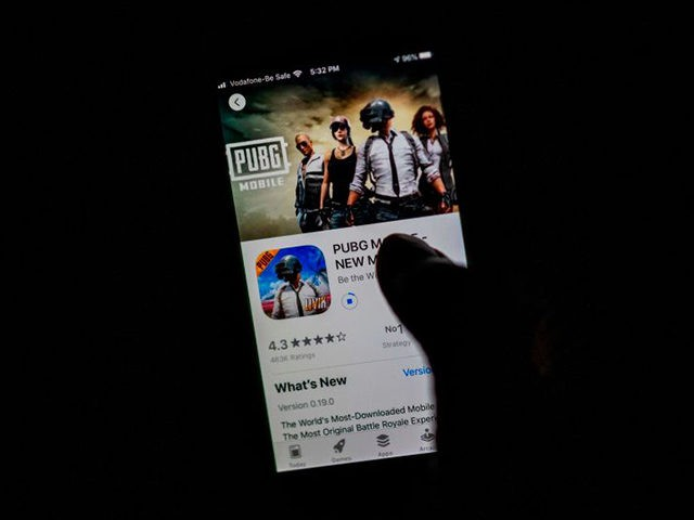 """A man looks at the """"PUBG Mobile"""" game, owned by Chinese internet giant Tencent, in the App Store on an Apple iPhone in New Delhi on September 2, 2020. - India on September 2 banned 118 Chinese apps as it stepped up economic hostilities over an increasingly bitter border showdown …"""